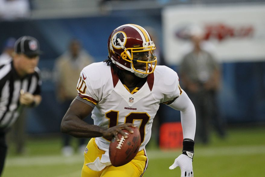 Washington Redskins quarterback Robert Griffin III (10) scrambles against the Chicago Bears in the first half of an NFL preseason football game in Chicago, Saturday, Aug. 18, 2012. (AP Photo/Charles Rex Arbogast)