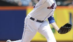 New York Mets' Collin McHugh delivers a pitch during the first inning of a baseball game against the Colorado Rockies, Thursday, Aug. 23, 2012, in New York.  (AP Photo/Frank Franklin II)