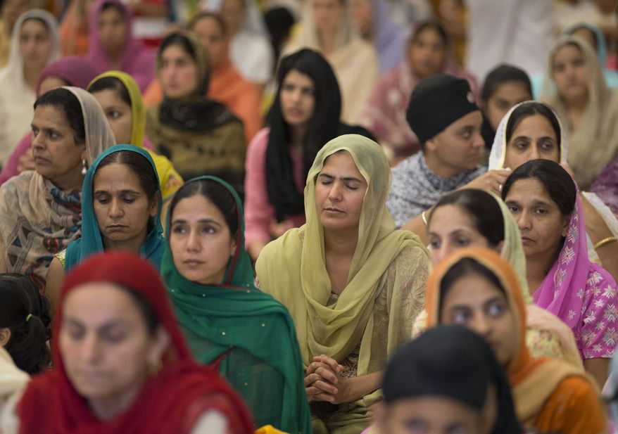 More than 100 people gather for a prayer service at the Sikh Temple of Wisconsin in Oak Creek, Wis., on Sunday, Aug. 12, 2012. (AP Photo/Jeffrey Phelps)