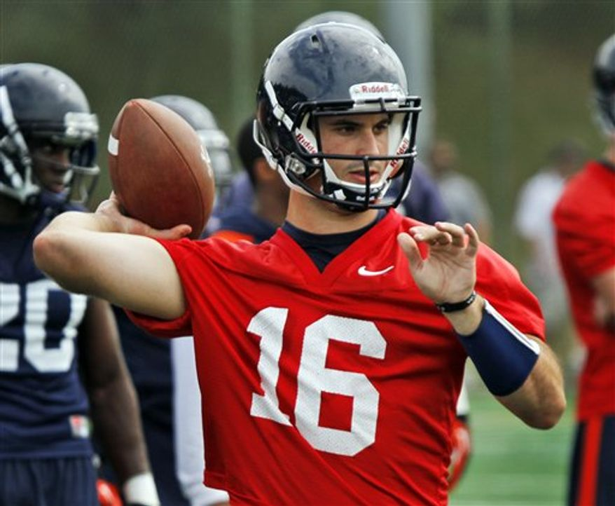 ** FILE ** This Aug. 6, 2012 photo shows Virginia quarterback Michael Rocco throwing during practice. Rocco walked out of spring camp as Virginia's quarterback and team leader. He's not yielding an inch now that Phillip Sims, a transfer from Alabama, has arrived in Charlottesville. (AP Photo/Steve Helber, File)