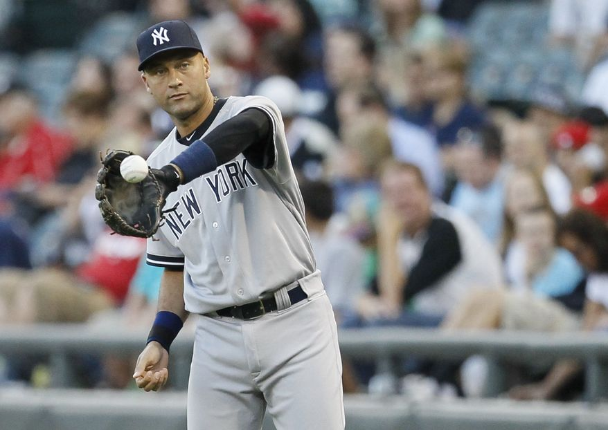 **FILE** New York Yankees shortstop Derek Jeter warms up before the Yankees' 7-3 loss against the Chicago White Sox on Aug. 21, 2012, in Chicago. (Associated Press)