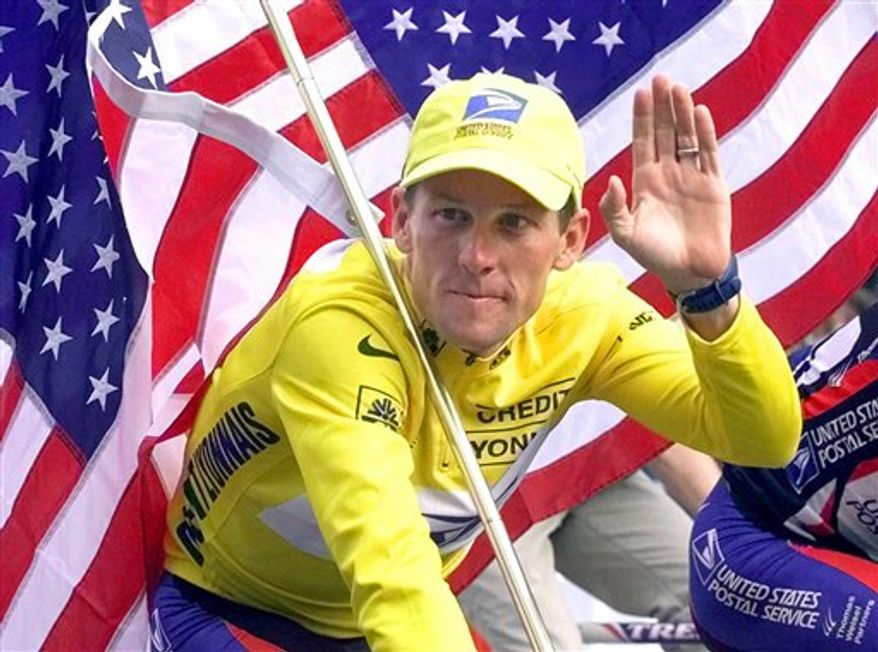 FILE - This July 23, 2000 file photo shows Tour de France winner Lance Armstrong riding down the Champs Elysees with an American flag after the 21st and final stage of the cycling race in Paris. The superstar cyclist, whose stirring victories after his comeback from cancer helped him transcend sports, chose not to pursue arbitration in the drug case brought against him by the U.S. Anti-Doping Agency. That was his last option in his bitter fight with USADA and his decision set the stage for the titles to be stripped and his name to be all but wiped from the record books of the sport he once ruled. (AP Photo/Laurent Rebours, File)