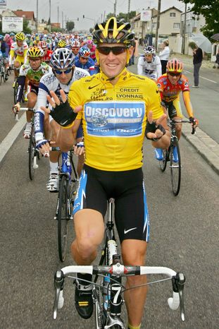 FILE - In this July 24, 2005, file photo, overall leader Lance Armstrong signals seven for his seventh straight win in the Tour de France cycling race as he pedals during the 21st and final stage of the race between Corbeil-Essonnes, south of Paris, and the French capital. The superstar cyclist, whose stirring victories after his comeback from cancer helped him transcend sports, chose not to pursue arbitration in the drug case brought against him by the U.S. Anti-Doping Agency. That was his last option in his bitter fight with USADA