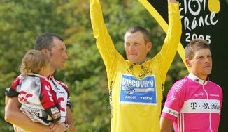 FILE - In this July 24, 2005 file photo,  Lance Armstrong gestures from the podium after winning his seventh straight Tour de France cycling race, as second-placed Ivan Basso of Italy, left, and third-placed Jan Ullrich of Germany, look on, after the 21st and final stage of the race in Paris. Armstrong, he superstar cyclist whose stirring victories after his comeback from cancer helped him transcend sports, chose not to pursue arbitration in the drug case brought against him by the U.S. Anti-Doping Agency. That was his last option in his bitter fight with USADA and his decision set the stage for the titles to be stripped and his name to be all but wiped from the record books of the sport he once ruled.  (AP Photo/Christophe Ena, File)