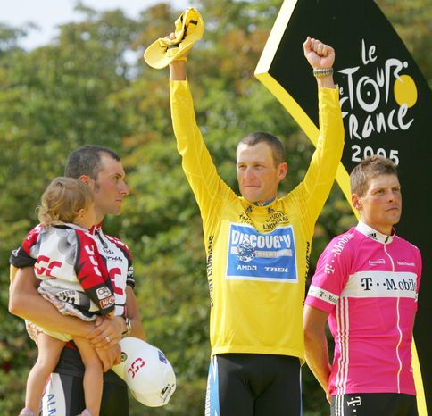 FILE - In this July 24, 2005 file photo,  Lance Armstrong gestures from the podium after winning his seventh straight Tour de France cycling race, as second-placed Ivan Basso of Italy, left, and third-placed Jan Ullrich of Germany, look on, after the 21st and final stage of the race in Paris. Armstrong, he superstar cyclist whose stirring victories after his comeback from cancer helped him transcend sports, chose not to pursue arbitration in the drug case brought against
