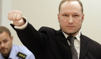 Mass murderer Anders Behring Breivik, makes a salute after he arrives at the court room in a courthouse in Oslo Friday, Aug. 24, 2012 . Breivik has been declared sane and sentenced to prison for bomb and gun attacks that killed 77 people last year. (AP Photo/Frank Augstein)