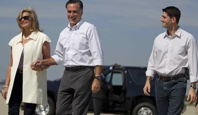 Republican presidential candidate, former Massachusetts Gov. Mitt Romney, center, and his wife Ann, arrive at the Oakland County International Airport with vice presidential running mate Rep. Paul Ryan, R-Wis., on Friday, Aug. 24, 2012 in Waterford, Mich. (AP Photo/Evan Vucci)