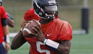 University of Virginia quarterback David Watford prepares to toss a pass during practice in Charlottesville, Va., Monday, Aug. 6, 2012.  ( AP Photo/Steve Helber)