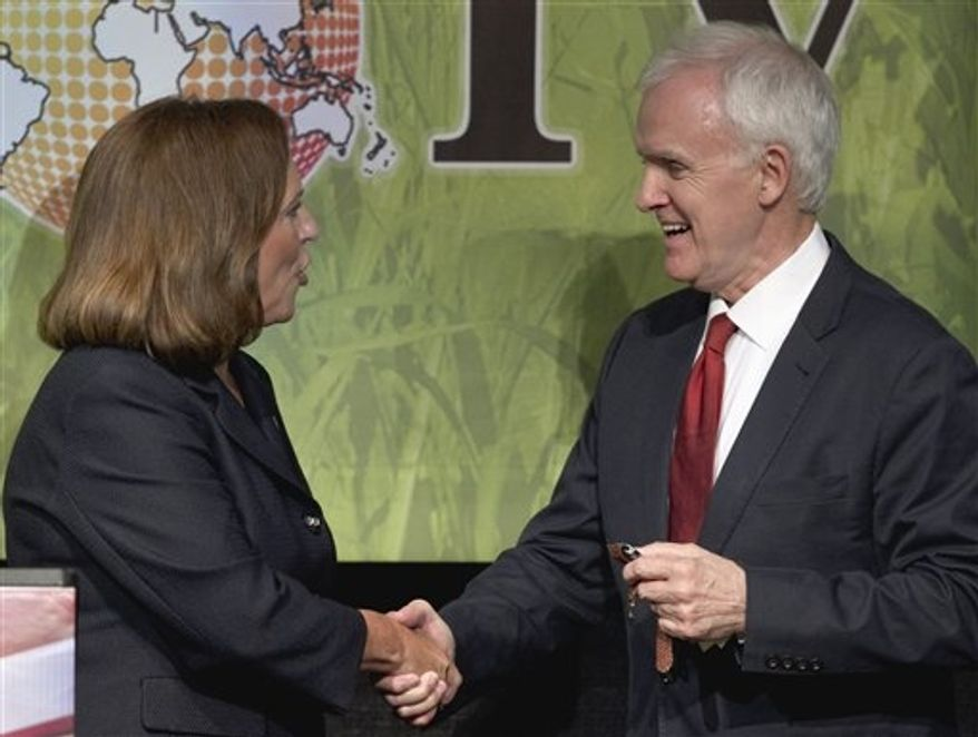 **FILE** Deb Fischer (left), the Republican candidate for the Nebraska Senate seat, shakes hands with her Democratic counterpart Bob Kerrey following their first debate at the Nebraska state fair in Grand Island, Neb., on Aug. 25, 2012. The two are vying for the Senate seat of Democrat Ben Nelson, who is not seeking re-election. (Associated Press)
