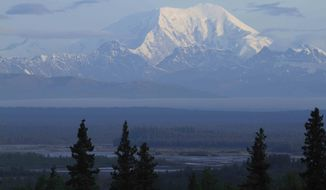 ** FILE ** Early morning sun shines on the south side of 17,400-foot Mount Foraker in Denali National Park on Sunday, Aug. 12, 2012, in a view from Talkeetna, Alaska. (AP Photo/Dan Joling)