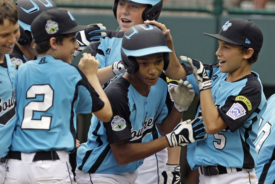 Goodlettsville, Tenn.'s Lorenzo Butler, center, celebrates with teammates after hitting a three-run home run off Petaluma, Calif., pitcher Andrew White in the fourth inning of the U.S. championship baseball game at the Little League World Series, Saturday, Aug. 25, 2012, in South Williamsport, Pa. It was Butler's second three-run home run of the game. (AP Photo/Gene J. Puskar)