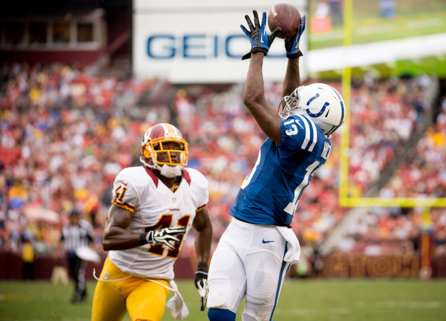 Washington Redskins defensive back Madieu Williams (41) can only watch as Indianapolis Colts wide receiver T.Y. Hilton (13) catches a touchdown pass to tie the game 7-7 in the second quarter as the Washington Redskins takes on the Indianapolis Colts in NFL preseason football at FedEx Field, Landover, Md., Saturday, August 25, 2012. (Andrew Harnik/The Washington Times)