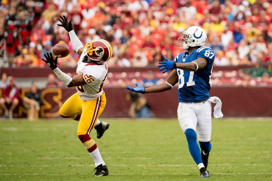 Washington Redskins defensive back Josh Wilson (26), left, breaks up a deep pass intended for Indianapolis Colts wide receiver Reggie Wayne (87) in the second quarter as the Washington Redskins take on the Indianapolis Colts in NFL preseason football at FedEx Field, Landover, Md., Saturday, August 25, 2012. (Andrew Harnik/The Washington Times)