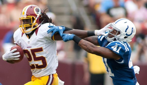 Washington Redskins running back Tim Hightower (25) breaks tacklers during second half action of the Indianapolis Colts at Washington Redskins preseason football game, Saturday, August 25, 2012 in Washington, DC. (Craig Bisacre/The Washington Times)