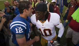 Washington Redskins quarterback Robert Griffin III (10) shakes hands with Indianapolis Colts quarterback Andrew Luck (12) at the end of the Indianapolis Colts at Washington Redskins preseason football game, Saturday, August 25, 2012 in Washington, DC. Redskins won 30 - 17. (Craig Bisacre/The Washington Times)