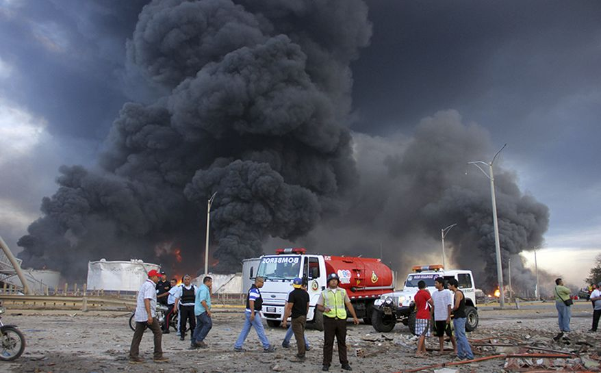 Firefighters and rescue teams work at the Amuay oil refinery after an explosion in Punto Fijo, Venezuela, Saturday, Aug. 25, 2012. (AP Photo/Diario EL Amanecer)