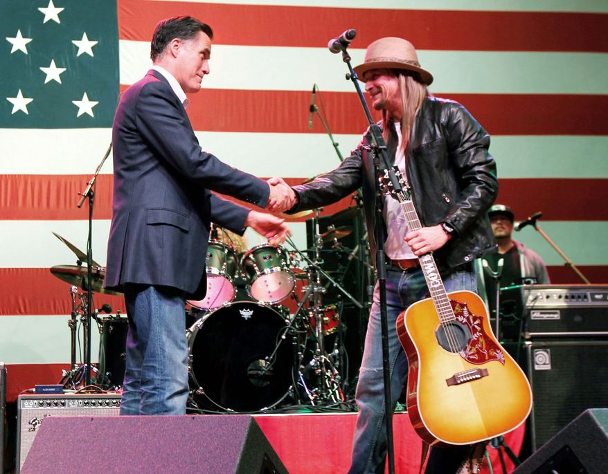 Mitt Romney shakes hands with Kid Rock after the rocker performed at a campaign rally in Royal Oak, Mich., during the primaries in February. (Associated Press)