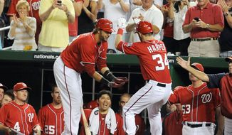 Bryce Harper gets congratulations from teammate Michael Morse and a lot of happy fans after hitting a solo home run against the Miami Marlins on Aug. 4. (Associated Press)