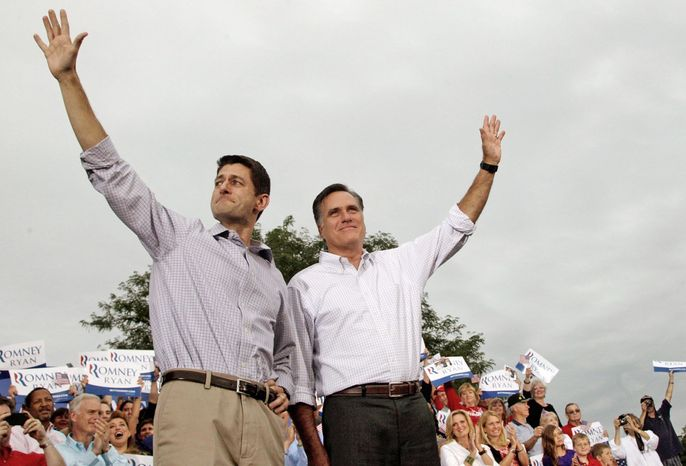 Former Massachusetts Gov. Mitt Romney and Rep. Paul Ryan of Wisconsin, his running mate, greet the crowd during an event in Waukesha, Wis., earlier this month. (Associated Press)