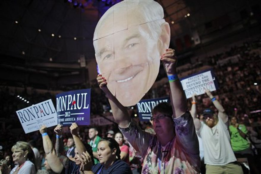 Mary White of Rathdrum, Idaho, shows her support for Rep. Ron Paul, R-Texas, at a rally at the University of South Florida Sun Dome on the sidelines of the Republican National Convention in Tampa, Fla., on Sunday, Aug. 26, 2012. (AP Photo/Charles Dharapak)