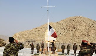 The French flag is lowered during a ceremony to transfer authority from French soldiers, who are part of NATO's forces, to Afghan security forces in Surobi, Afghanistan, east of Kabul, on Tuesday, July 31, 2012. (AP Photo/Musadeq Sadeq)