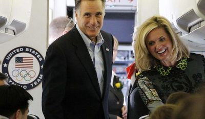 Republican presidential candidate and former Massachusetts Gov. Mitt Romney and his wife Ann board his charter plane at London Stansted Airport, Saturday, July 28, 2012, as he travels to Israel. (AP Photo/Charles Dharapak)