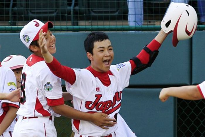 Tokyo's Noriatsu Osaka, right, celebrates with Satoru Aoyama after hitting a walk-off, two-run home run against Goodlettsville, Tenn., in the fifth inning of the Little League World Series championship baseball game in South Williamsport, Pa., Sunday, Aug. 26, 2012. Tokyo won 12-2 in five innings. (AP Photo/Gene J. Puskar)