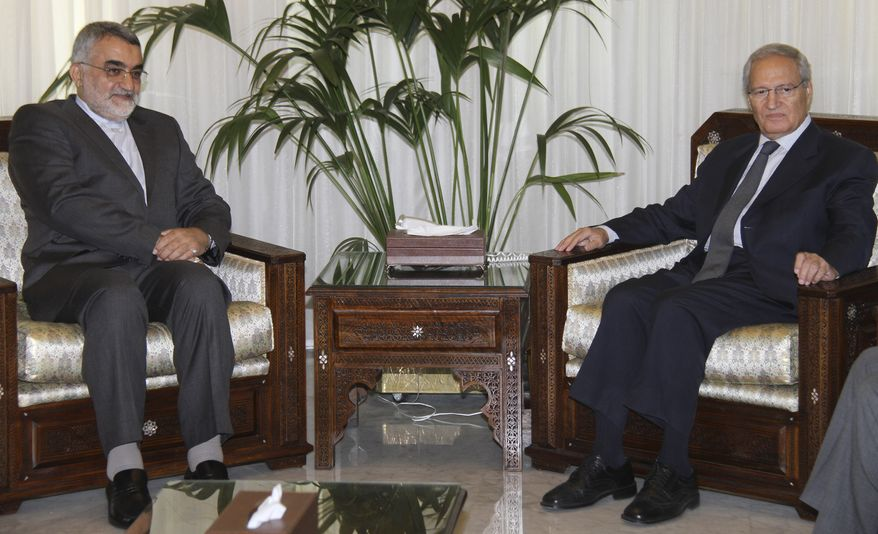 Alaeddin Boroujerdi (left), head of Iran's powerful parliamentary committee on national security and foreign policy, meets with Syrian Vice President Farouk al-Sharaa in Damascus, Syria, on Sunday, Aug. 26, 2012.  Mr. al-Sharaa's appearance at the meeting ended rumors that he had defected to Jordan. (AP Photo/Bassem Tellawi)