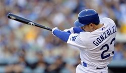 Los Angeles Dodgers' Adrian Gonzalez swings on a three-run home run during the first inning of a baseball game against the Miami Marlins, Saturday, Aug. 25, 2012, in Los Angeles. (AP Photo/Mark J. Terrill)