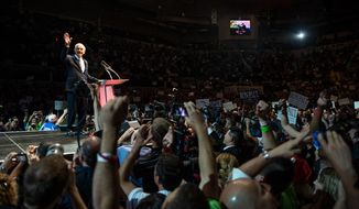 "Ron Paul waves to supporters as he takes the podium at the ""We Are the Future Rally"" at the Sun Dome at the University of South Florida, Tampa, Fla., Sunday, August 26, 2012.   (Andrew Harnik/The Washington Times)"