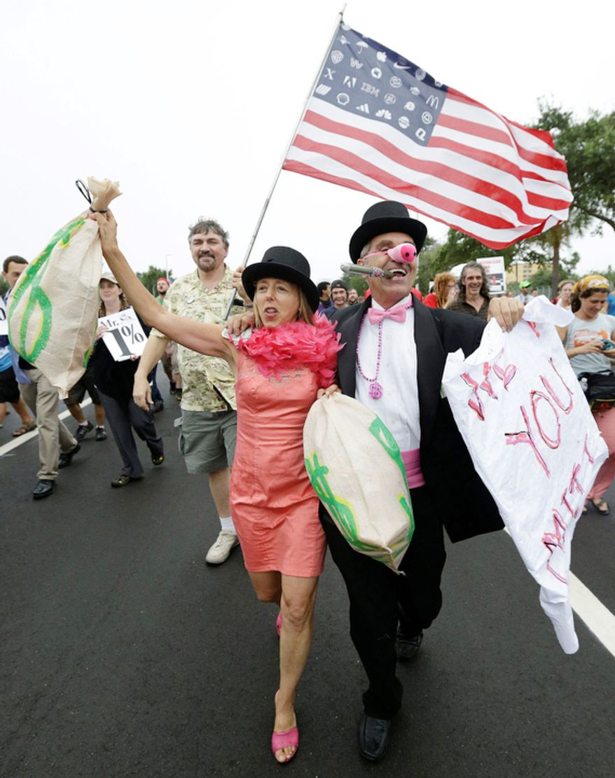 Demonstrators chant and walk during a protest march in St Petersburg, Fla. (AP Photo/Patrick Semansky)