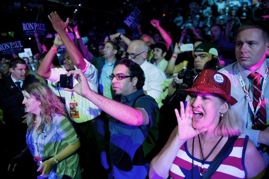 "Crowds cheer as Ron Paul is introduced at the ""We Are the Future Rally"".   (Andrew Harnik/The Washington Times)"