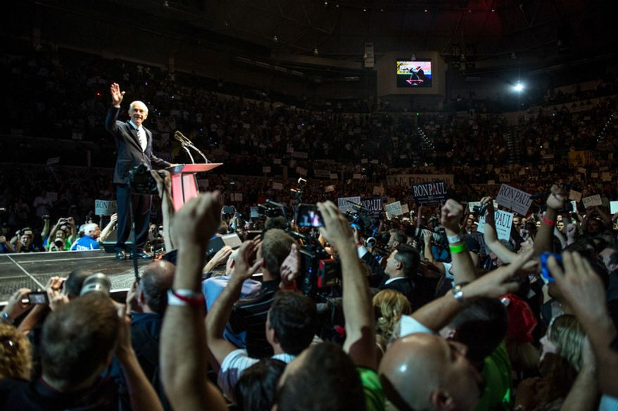Ron Paul waves to supporters as he takes the podium.   (Andrew Harnik/The Washington Times)