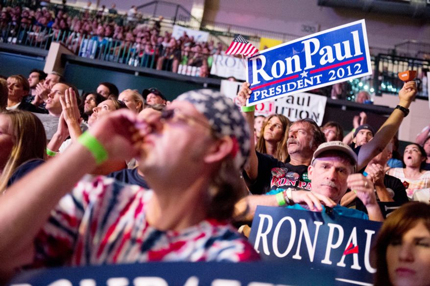 """Ron Paul supporters applaud for speakers at the """"We Are the Future Rally"""". (Andrew Harnik/The Washington Times)"""