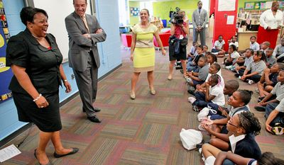 D.C. Schools Chancellor Kaya Henderson and Mayor Vincent C. Gray are introduced by principal Izabela Miller at Amidon-Bowen Elementary School in the District on the first day of school on Aug. 27, 2012.