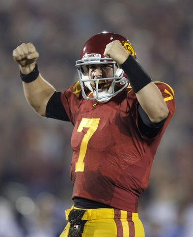 FILE - In this Nov. 26, 2011 file photo, Southern California quarterback Matt Barkley celebrates a touchdown by teammate Rhett Ellison during the first half of an NCAA college football game against UCLA in Los Angeles. USC is ranked