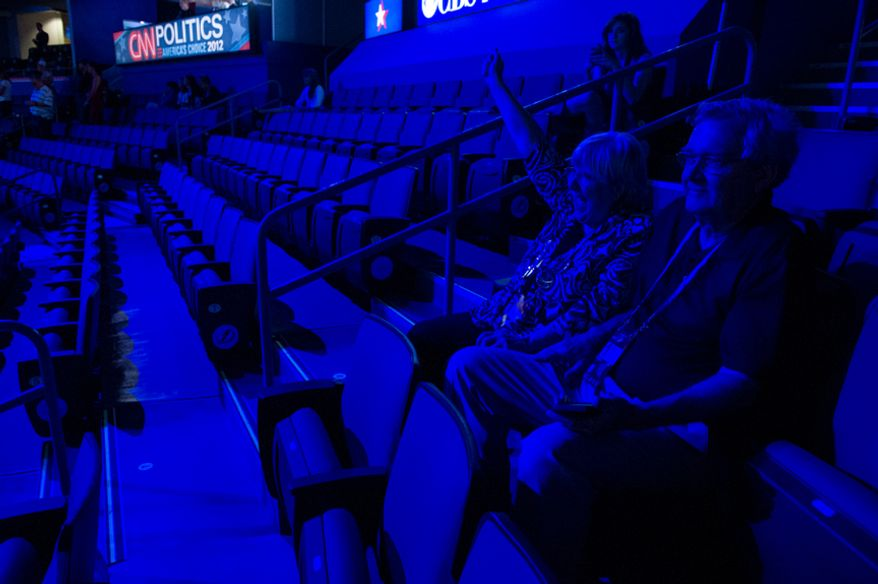 Sharon Dale of Fort Worth, Texas, cheers as she and her husband, Kennith, watch a video for Republican presidential candidate Mitt Romney on Aug. 27, 2012, at the Republican National Convention, inside a mostly empty Tampa Bay Times Forum in Tampa, Fla. (Andrew Harnik/The Washington Times)