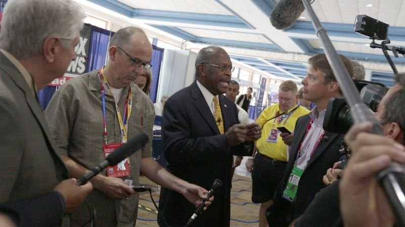 Herman Cain talks with reporters at the National Republican Convention (RNC), in Tampa, FL., Monday, August 27, 2012. The RNC will run from the 27th through the 30th of August.(Andrew S