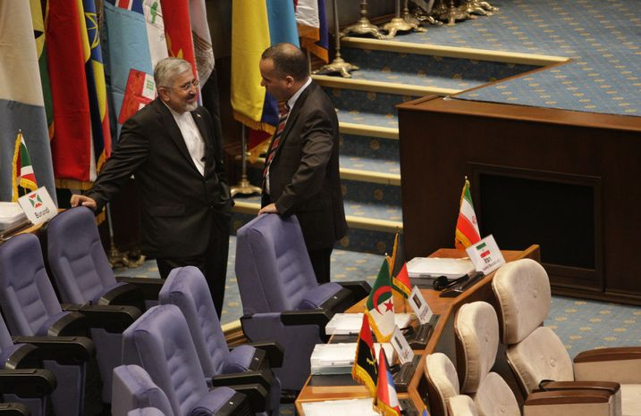 Ali Asghar Soltanieh (left), Iran's envoy to the International Atomic Energy Agency, talks with a foreign diplomat before the start of an expert-level meeting of the Non-Aligned Movement in Tehran on Sunday, Aug. 26, 2012.  (AP Photo/Vahid Salemi)