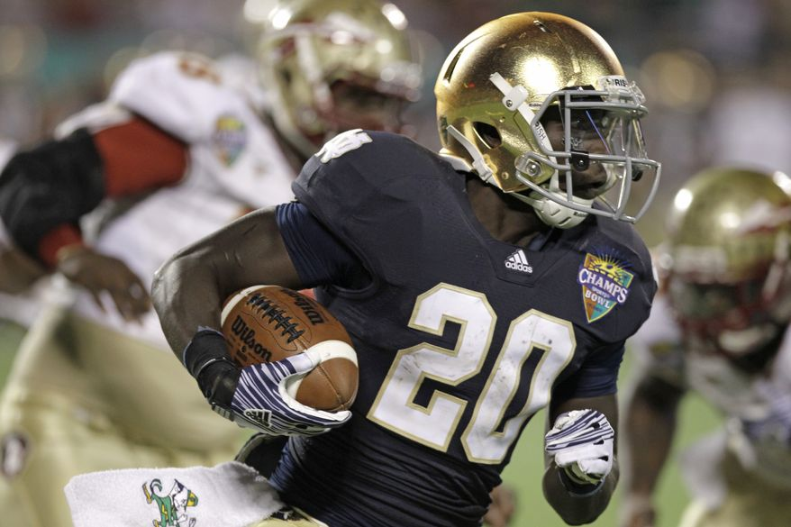 FILE - In this Dec. 29, 2011, file photo, Notre Dame's Cierre Wood gains yardage against Florida State during the second half of the Champs Sports Bowl NCAA college football game in Orlando, Fla. Notre Dame suspended Wood for two games for violating team rules, leaving the Fighting Irish without their 1,000-yard rusher against Navy and Purdue. (AP Photo/John Raoux, File)