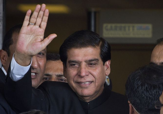 ** File ** Pakistani Prime Minister Raja Pervaiz Ashraf waves upon his arrival for a hearing at the Supreme Court in Islamabad on, Aug. 27, 2012. (Associated Press)