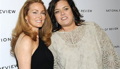 ** FILE ** This Jan. 10, 2012 photo shows television personality Rosie O'Donnell, right, and her girlfriend Michelle Rounds at the National Board of Review awards gala in New York. O'Donnell wed Rounds in a private ceremony in June, just days before Rounds had surgery to treat desmoid tumors. O'Donnell announced their marriage on her blog Monday, Aug. 27. (AP Photo/Evan Agostini, file)