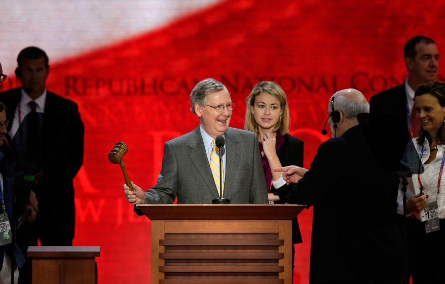 Senate Minority Leader Mitch McConnell, Kentucky Republican, checks out the stage Aug. 27, 2012, at the Republican National Convention inside the Tampa Bay Times Forum in Tampa, Fla. (Associated Press)