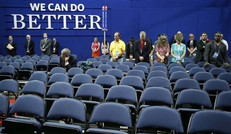 Many empty chairs are seen in the Louisiana delegate section on the convention floor as Chairman of the Republican National Committee Reince Priebus gavels the Republican National Convention open in Tampa, Fla., on Monday, Aug. 27, 2012. (AP Photo/Jae C. Hong)