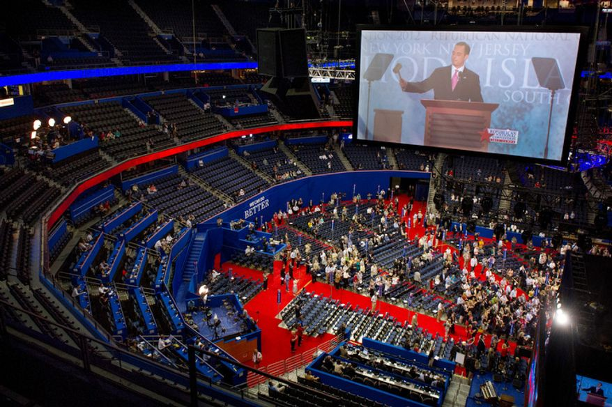 Chairman of the Republican National Committee Reince Priebus performs a symbolic gaveling in for the start of the Republican National Convention to a mostly empty room and promptly calls a recess on the first day of events because of Hurricane Isaac, Tampa, Fla., Monday, August 27, 2012.   (Andrew Harnik/The Washington Times)
