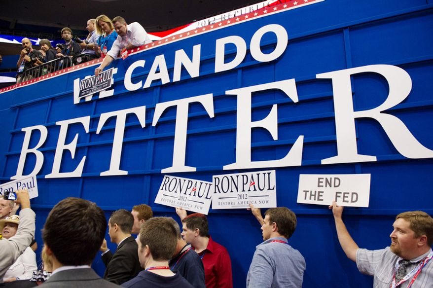 Ron Paul supporters gather on the side of the Republican National Convention floor after Chairman of the Republican National Committee Reince Priebus calls a recess on the first day of events because of Hurricane Isaac.   (Andrew Harnik/The Washington Times)
