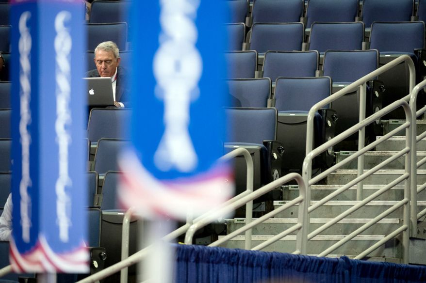 Dan Rather works on his laptop just off the Republican National Convention floor after Chairman of the Republican National Committee Reince Priebus calls a recess on the first day of events because of Hurricane Isaac, Tampa, Fla., Monday, August 27, 2012.   (Andrew Harnik/The Washington Times)