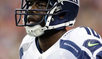FILE - In this Aug. 18, 2012, file photo, Seattle Seahawks wide receiver Terrell Owens appears during the first half of a preseason NFL football game against the Denver Broncos in Denver. Owens tweeted on Sunday, Aug. 26, that he is no longer a member of the Seahawks, part of the league-mandated roster reductions from 90 to 75 players. The 38-year-old posted a message on his Twitter account shortly before 11 a.m. PDT that he had been released. (AP Photo/Joe Mahoney, File)