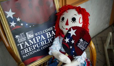 A Raggedy Ann doll holds a paper fan with the logo of the 2012 Republican National Convention at the store The Attic on Seventh, in Ybor City, Fla., Monday, August 27, 2012. (Rod Lamkey Jr./The Washington Times)