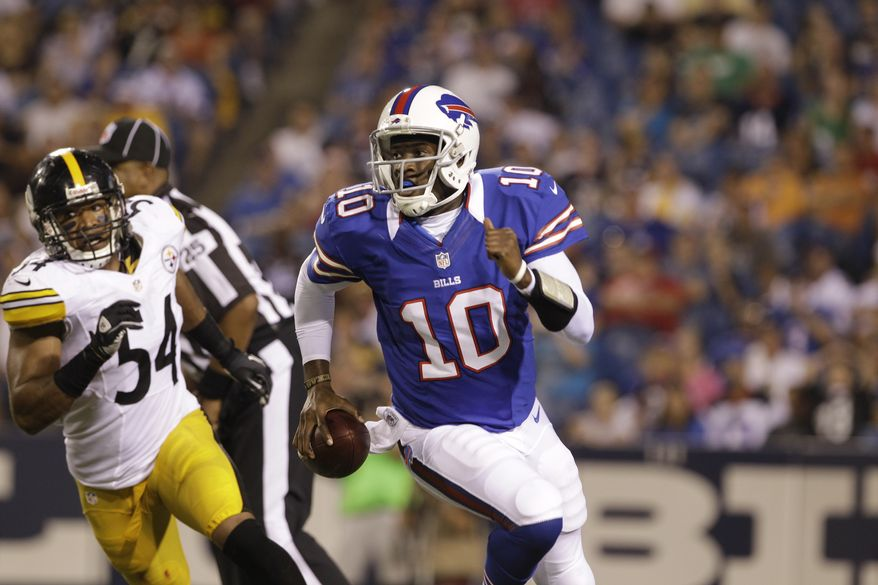 Buffalo Bills' Vince Young is pressured by Pittsburgh Steelers' Chris Carter (54) during the second half of a preseason NFL football game in Orchard Park, N.Y., Saturday, Aug. 25, 2012. (AP Photo/Doug Benz)